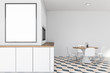 White kitchen interior with table and poster