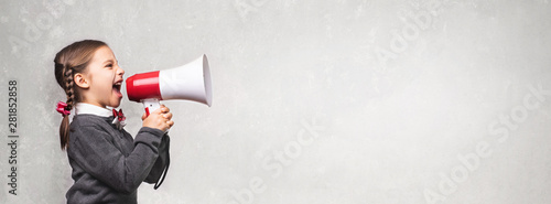 Slika na platnu Child Girl Student Shouting Through Megaphone on Grey Backdrop w