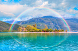 Fototapeta Rainbow - Paraglider flies in the sky - Oludeniz Beach And Blue Lagoon, Fethiye