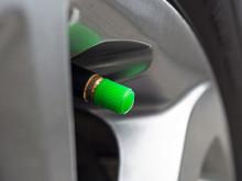 A Green Tire Valve Caps