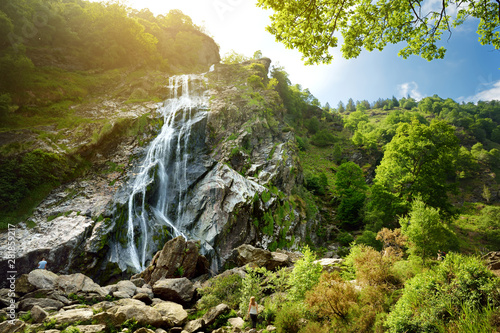 Poster Cascades Majestic water cascade of Powerscourt Waterfall, the highest waterfall in Ireland. Tourist atractions in co. Wicklow, Ireland.