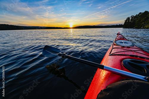 red plastic kayak on calm water in the sunset Tapéta, Fotótapéta