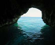Entrance Of Cave In Clear Azur...
