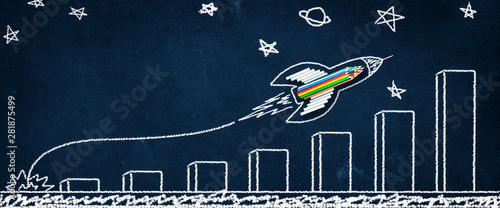 Rocket Made From Pencils And Chalk With Growth Chart Drawing On Chalkboard Background Shooting For The Stars - Back To School / Business Entrepreneur Concept