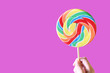 canvas print picture - Colorful Lollipop on a Pink Background