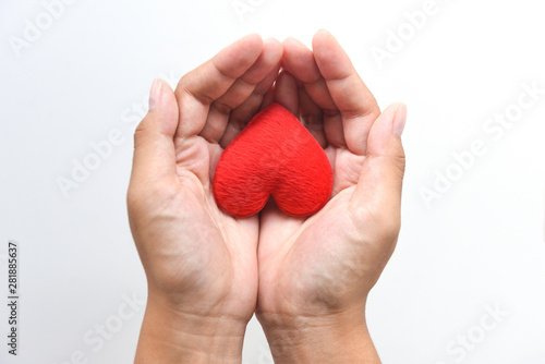 Fotografia heart on hand for philanthropy concept - woman holding red heart in hands for va