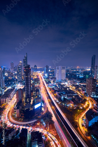 night vertically cityscape of bangkok amazing view of taksin bridge