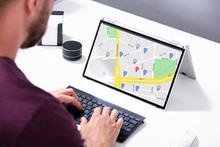 Man Browsing GPS Map On Laptop