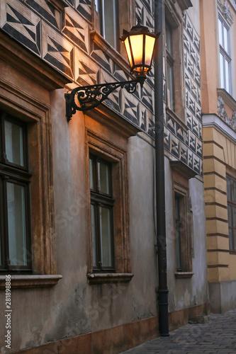 Fototapeta KRAKOW,POLAND - OCTOBER 14, 2015: Kanonicza street in early evening light obraz