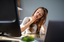 Businesswoman Yawning In Office