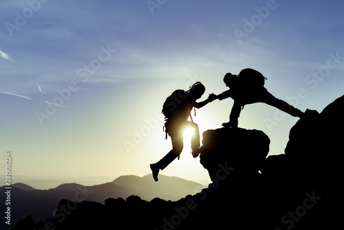 Fototapeta fight for the goal and reach the summit together obraz
