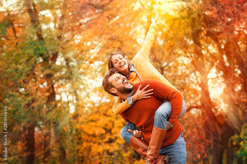 Fototapeta Young couple having fun outdoor.