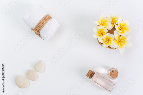 Keuken foto achterwand Frangipani Spa concept,white towels,rose liquid soap,Plumeria flower and zen stone over white background,top view with space for text