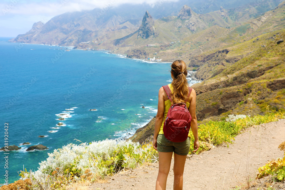 Fototapety, obrazy: Lady tourist with a backpack standing on mountain enjoy the beautiful landscape of Tenerife Island