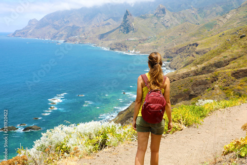 Lady tourist with a backpack standing on mountain enjoy the beautiful landscape Fototapeta
