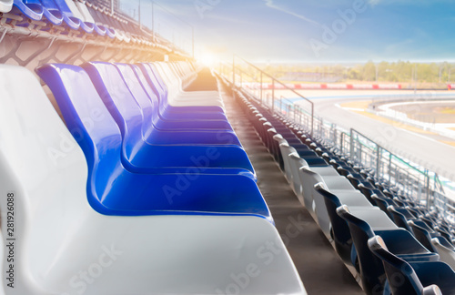 Plastic chairs white and blue in the stadium - 281926088