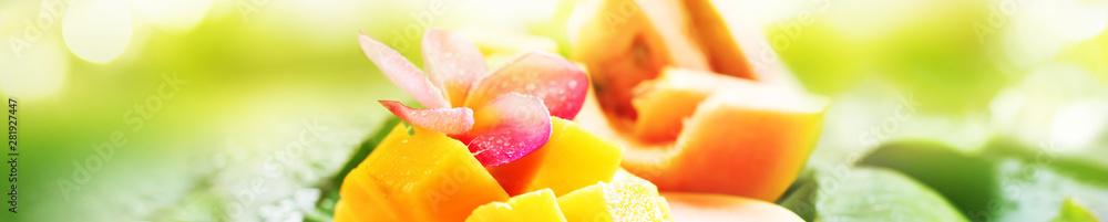 Sliced mango water melon papaya fruits wet palm