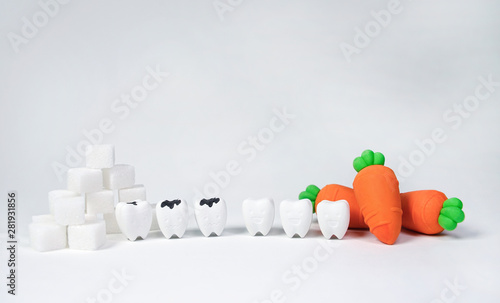 Obraz na plátně  Smile Tooth with Carrot If You Eat Vegetables That Are Good For Your Teeth and