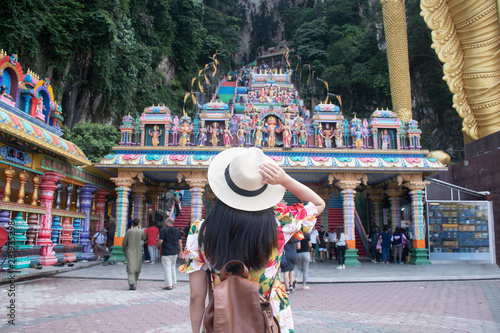 A tourist woman is sightseeing at Batu cave Hindu temple in Kuala Lumpur, Malaysia Canvas Print