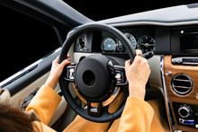 Woman's Hands On The Steering ...