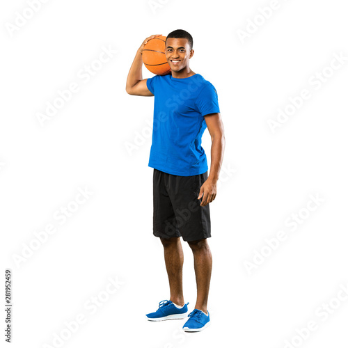 Full-length shot of Afro American basketball player man over isolated white background Wall mural