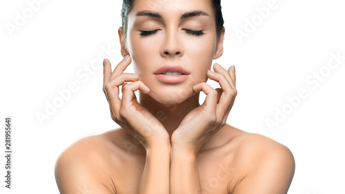 Beautiful girl with closed eyes and clean skin natural gentle refreshing makeup on a white background isolated on white background. hands on face