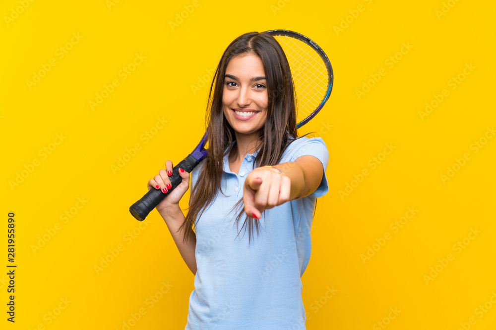 Fototapety, obrazy: Young tennis player woman over isolated yellow wall points finger at you with a confident expression