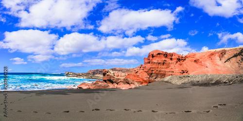 Unique nature of Lanzarote. Black sandy beach with colorful rocks El Golfo. Canary islands