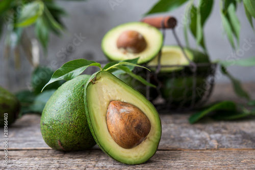 Foto Fresh green avocado on wooden background