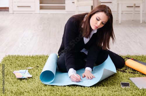 Vászonkép Female designer working in the office