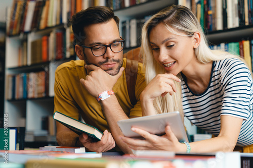Happy young university students friends studying with tablet at university - Sto Canvas Print