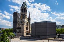 Kaiser-Wilhelm-Kirche, Broken Spire And Modern Bell Tower Overlook The Busy Breitscheidplatz As Symbols Of The City's Regeneration. Berlin, Germany