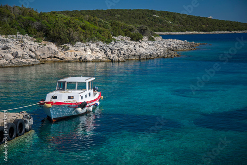 Recess Fitting Blue Boats in a quiet bay of Milna on Brac island, Croatia