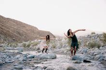 Two Wild Women Dancing In Dese...