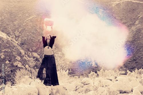 Fotografía Shamanic woman raising the vibration with energy magic.