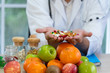 Blurred soft images of male nutritionists are presenting fresh food and fruit extracts To be and alternative For health care conscious people to clean food concept.