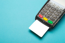 Credit Card Terminal On Blue Background. Close Up Of Merchant  Payment Device, Card Machine.
