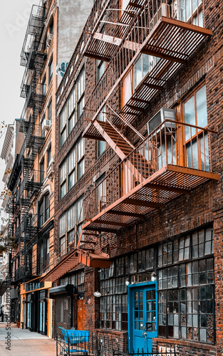 Aluminium Prints Sydney One Industrial old apartment facades, with fire stairs. Soho, Manhattan. NYC