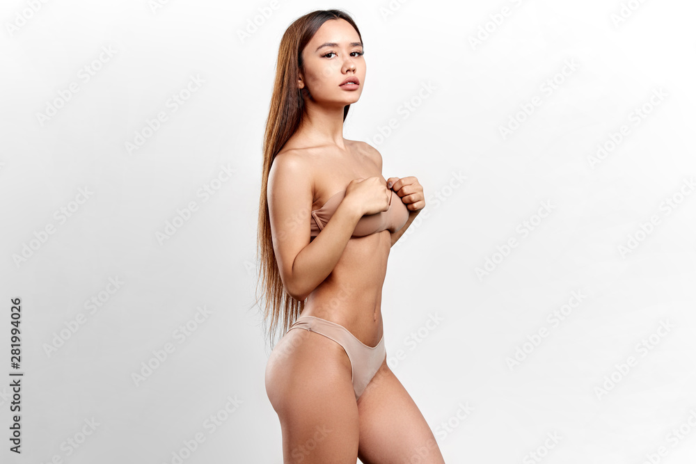 Fototapety, obrazy: slim sexy girl with palms on her breast showing her perfect muscular body. wellness, wellbeing. isolated white background, studio shot