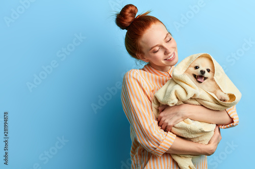 attractive girl in stylish striped shirt adores her animal Wallpaper Mural