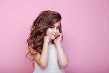 Portrait Of Beautiful Little Girl In Dress On Pink Background