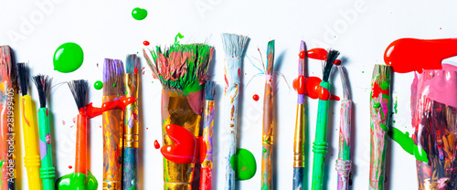 Obraz Row Of Messy Colorful Paint Brushes On Isolated White Background - Creativity Concept - fototapety do salonu