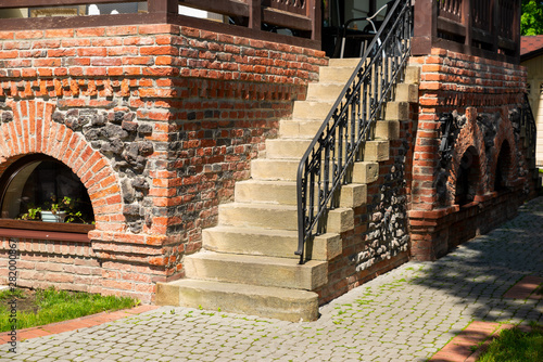 stone steps at a brick building with wrought iron railing Fototapet