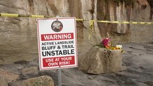Warning Sign And Flowers At Si...
