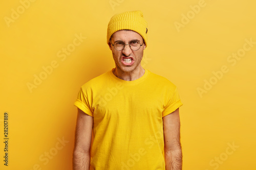 Portrait of irritated man looses temper, clenches teeth from anger, wrinkles nos Wallpaper Mural