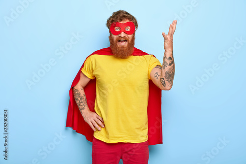 Pinturas sobre lienzo  Irritated superhero raises arm and gestures with annoyance, has much work, wears special costume, pretends having supernatural power, outraged to fight with evil, poses indoor