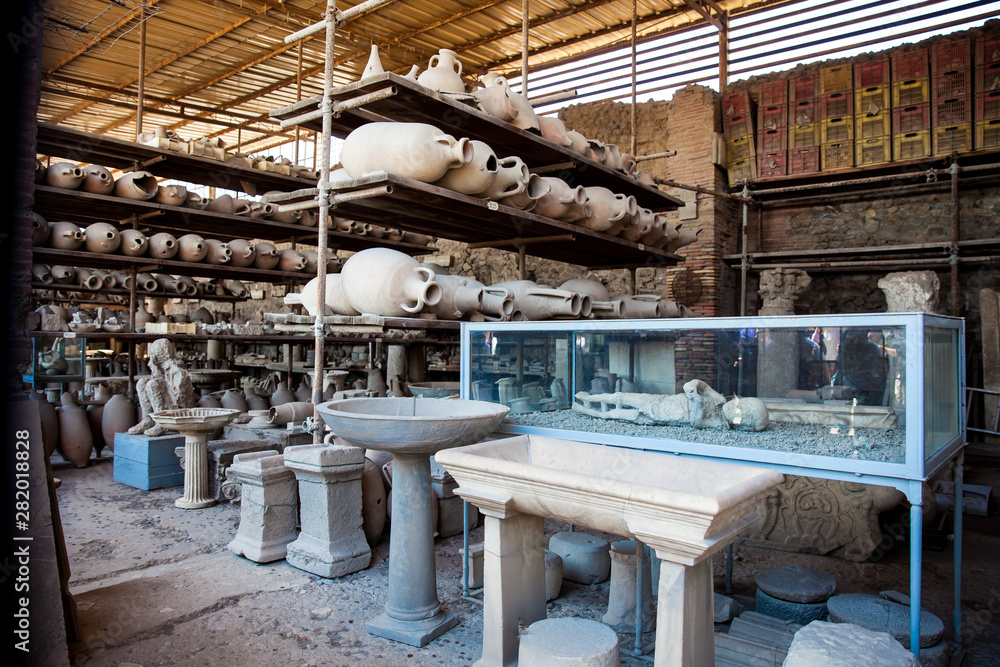 Fototapety, obrazy: Plaster cast of a child and artifacts in the Forum Granary of the ancient city of Pompeii
