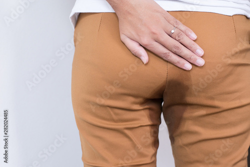 Fotomural  Hands woman holding her bottoms,Female need to pee,Urinary stain incontinence,Co