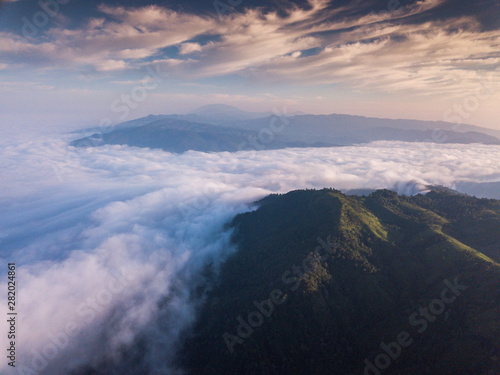 Foto  Mountain landscape mist nature and sky clouds