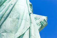 Detail Of The Lady Liberty Statue, Book With The Date Of USA's Independence